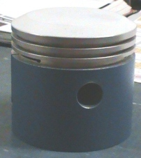 Teflon coated Model T piston