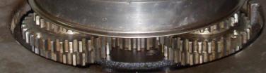 Triple gears mounted on the flywheel