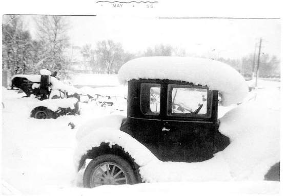 Model T Ford Coupe buried in snow, Canada 1955